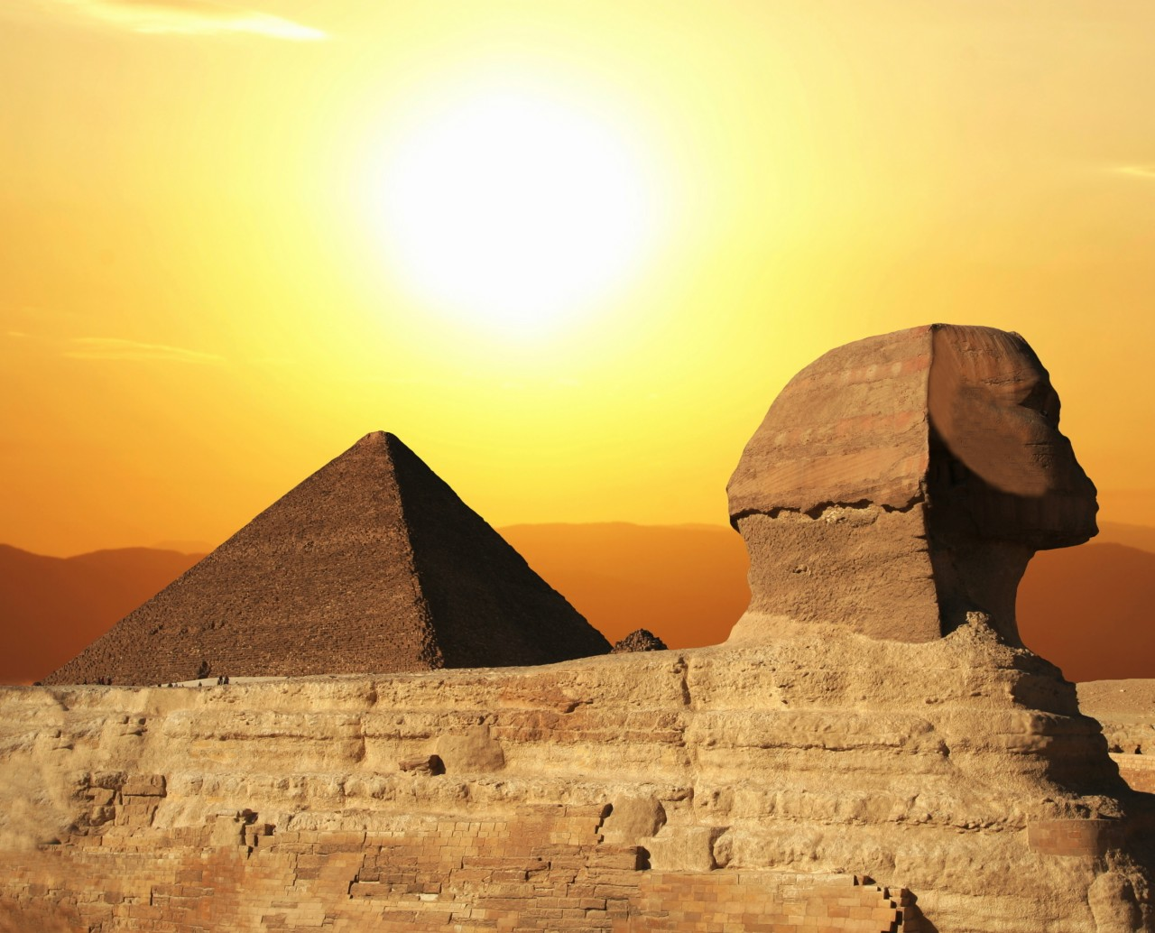 Egyptian-sphinx-and-pyramid-on-sunset